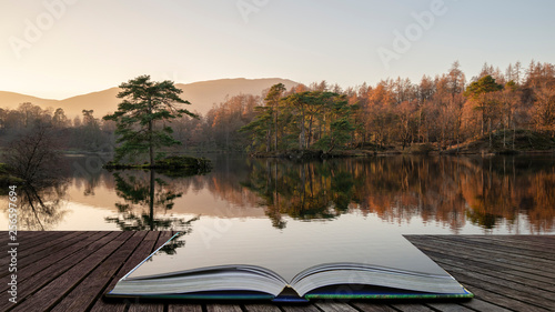 Montage in der Fensternische Dunkelbraun Beautiful landscape image of Tarn Hows in Lake District during beautiful Autumn Fall evening sunset with vibrant colours and still waters coming out of pages in magical story book
