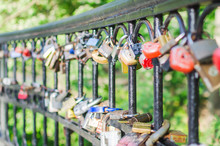 Hinged Love Locks Hanging On A Bridge