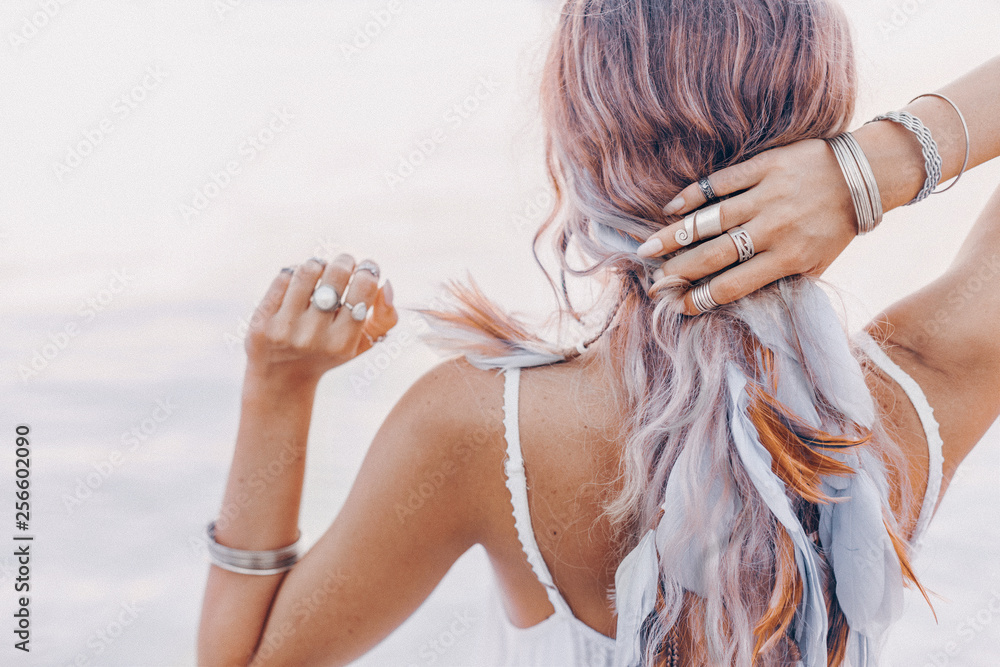 Fototapeta beautiful young boho woman close up with pink feathers and accessories at sunset