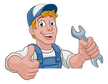Mechanic Plumber Maintenance Handyman Cartoon Mascot Man Holding A Wrench Or Spanner. Peeking Over A Sign And Giving A Thumbs Up
