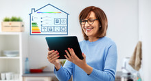 Technology, Automation And Efficiency Concept - Smiling Senior Woman In Glasses With Tablet Computer Using Smart Home App Over Grey Background