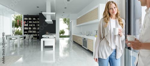 Foto Couple in modern open plan kitchen