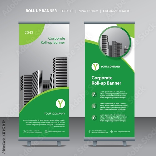Photo  business roll up design template green color scheme with city background