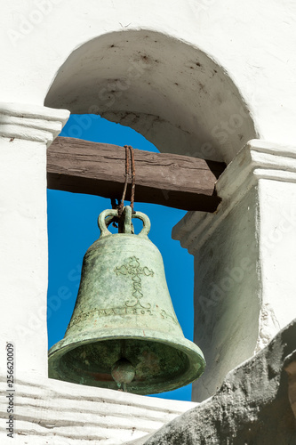 Close up of bronze bell on Spanish mission Basilica San Diego de