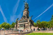 Lovely View Of The Monument Niederwalddenkmal On A Nice Sunny Day With A Blue Sky. The Germania Sculpture On Top Is A Famous Tourist Attraction And Was Built To Commemorate The Unification Of Germany.