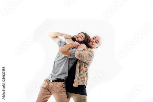 Fotografie, Obraz  the image of an angry man strangles a man, aggression, wickedness, isolated whit