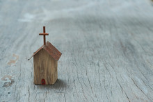 Small Wooden Church Model On Wooden Background, Still Life Photography With Selective Focus Narrow Depth Of Field On The Church