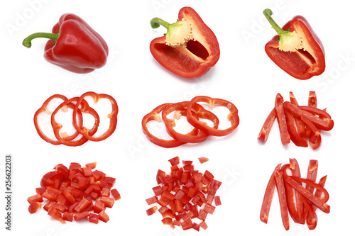 Set of fresh whole and sliced sweet red pepper - isolated on white Fototapete