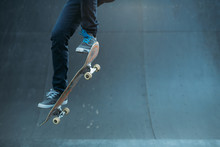 Skateboarding Hobby. Man Active Life. Guy On Skateboard Performing Ollie Trick On Ramp. Copy Space.