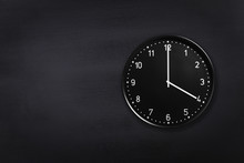 Black Wall Clock Showing Four ...