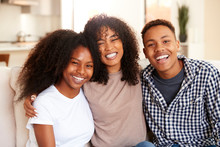 Black Teen And Young Adult Brother And Sisters Smiling To Camera, Close Up