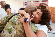 Millennial Black Soldier Returning Home To His Family, Embracing His Mother, Close Up