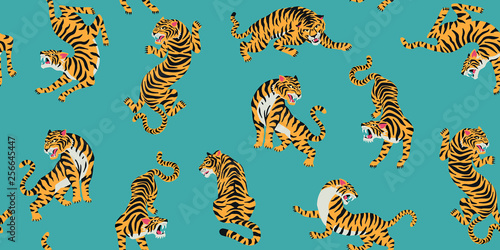 obraz PCV Vector seamless pattern with cute tigers on background. Fashionable fabric design.