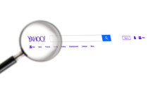 Yahoo Website Under A Magnifying Glass. Yahoo Is Tech Company, Leader In Search Engine Service And Information Technology Web Portals. Moscow, Russia - November 28, 2018