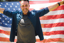 Happy Man Standing Outdoors Holding American Flag
