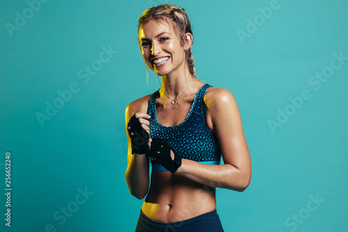 Smiling female fitness model