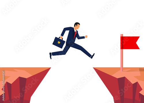 Businessman jumping over obstacle. Jumping oveer chasm Fototapet