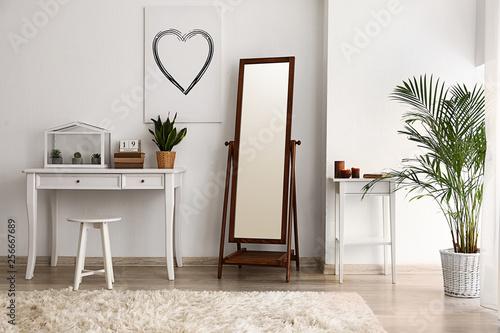 Interior of beautiful room with big mirror