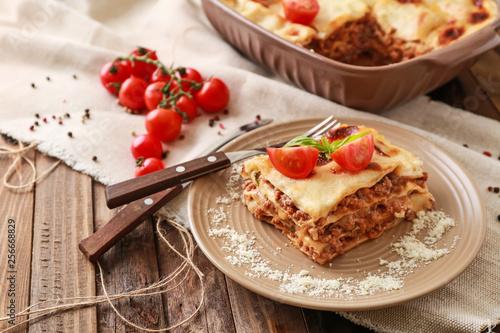 Fototapeta Tasty baked lasagna on wooden table obraz