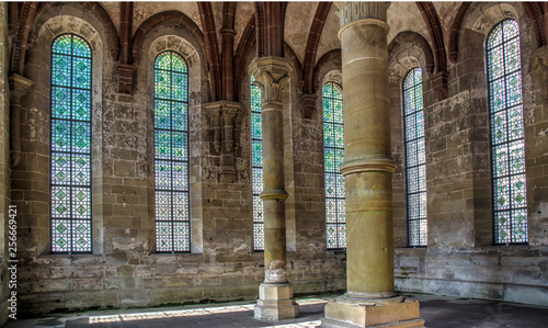 Canvas Prints Old building columns in cloister artful glass windows