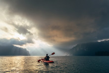 Man On Kayak Meetting Sunrise ...