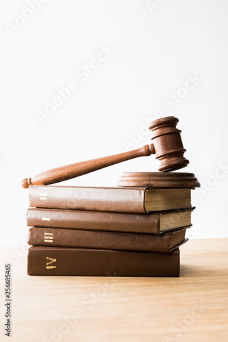 Valokuva  gavel on pile of brown books on wooden table isolated on white