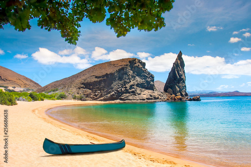 Foto auf Leinwand Blau Jeans Galapagos Islands. Ecuador. Bartolome Island. Pinnacle Rock. Rocks in the water next to the sandy beach. Blue lagoon. Landscapes of the Galapagos.
