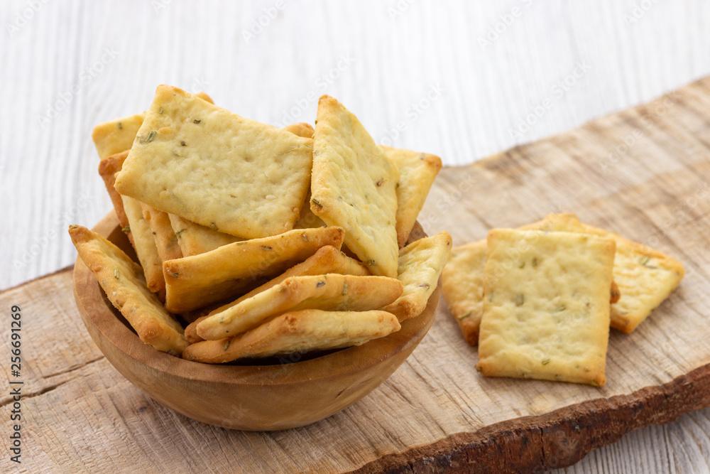 Fototapeta Dry salty cracker cookies in bowl on the table