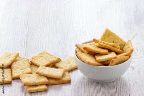 Dry salty cracker cookies in bowl on the table Fotobehang