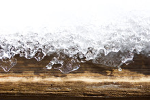 Macro Background Abstract Of Designs In Melting Snow On A Wooden Surface In Early Spring