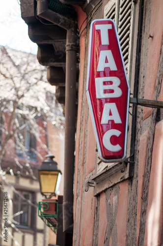 Cuadros en Lienzo closeup of red tabacco sign with french text tabac, the traduction in english of