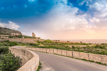Malta: Scenic Road To Ghar Lapsi Tower With Hilly Landscape And Sea