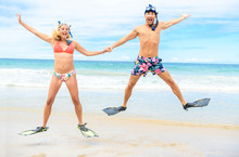 Couple On The Beach Is Going To Swim And Snorkle On Hawaii Beach