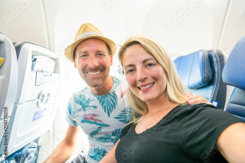Photographie  The Mid adult couple in economy class airliner