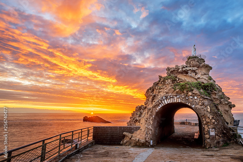 Biarritz, France, Rock of the Virgin on dramatical sunset Wallpaper Mural