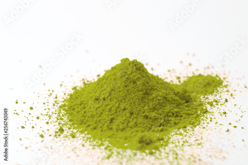Fototapeta Alternative medicine, herbal pain management and opioid withdrawal treatment concept theme with a pile of green kratom powder isolated on white background obraz