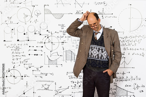 Middle aged caucasian mathematician explaining equations on a white wall Wallpaper Mural