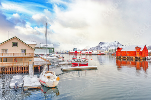 Svolvaer - northern Norwegian town over polar circle on Lofoten islands. Beautiful scene of traditional Scancinavian harbour of small arctic village. Rorbu fishing house and yachts at background.
