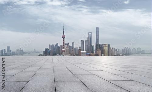 Foto auf Leinwand Shanghai empty brick floor and cityscape of modern city near , shanghai