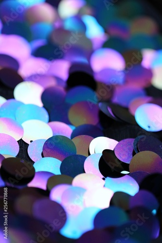 Sequins macro background.Large holographic sequins in purple and blue tones.ridescent fabric.Scales background. fabric background.sparkling sequined textile - 256770868