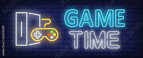 Fototapeta Game time neon text with game console and controller
