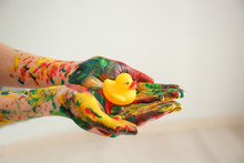 Painted Female Hands Holding Rubber Duck, Closeup
