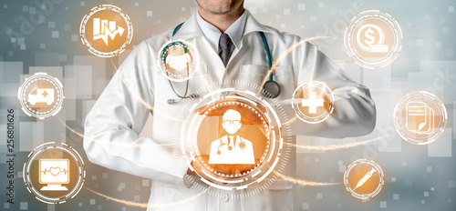 Fotografie, Obraz  Health Insurance Concept - Doctor in hospital with health insurance related icon graphic interface showing healthcare people, money planning, risk management, medical treatment and coverage benefit