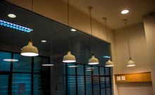 Lighting Fixture Lamps Are Hanging On Textile Classic Cable From The Ceiling