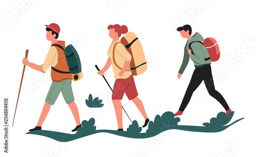 Fotografia Hikers or backpackers walking men and woman sport or outdoor activity