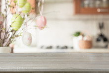 Easter. Blurred Kitchen And Wooden Tabletop With Space For Display Your Product.