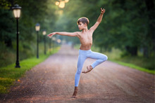Boy Dancing In The Park