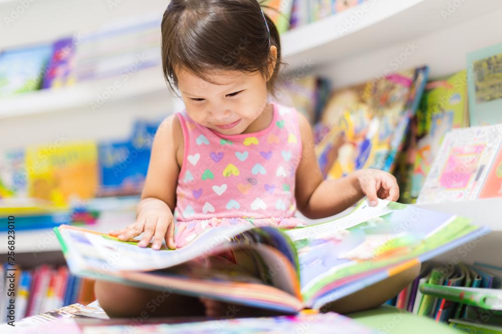 Fototapety, obrazy: Little girl reading a book. Education.
