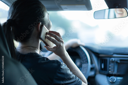 Fototapeta  Talking on the phone while driving