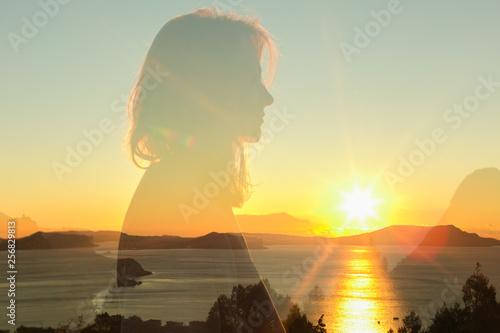Fototapeta double exposure warm profile portrait of young woman wearing sweatshirt, sea , h
